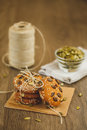 Homemade biscuits with sesame seeds and chocolate cookies on wooden table on sackcloth background Stock Photography