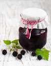 Homemade blackberry jam jar of on a wooden background Stock Photo