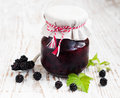 Homemade blackberry jam jar of on a wooden background Stock Photos