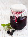 Homemade blackberry jam jar of on a wooden background Royalty Free Stock Photo