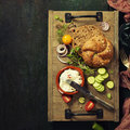 Homemade bread loaf and fresh ingredients for making vegetarian Royalty Free Stock Photo