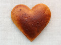 Homemade bread in the shape of heart photo Royalty Free Stock Images