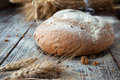 Homemade bread and wheat ears closeup Stock Photo