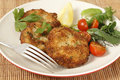 Homemade breaded fishcakes with a salad easy to make steamed fish crumbled into mashed potato and parsley mix thickened some flour Stock Image