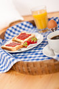 Homemade breakfast on wicker tray Stock Photography