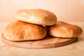 Homemade buns for breakfast on the board. Shallow depth of field Royalty Free Stock Photo