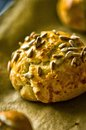 Homemade buns with sunflower seeds closeup photo of tasty topping Royalty Free Stock Image