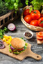 Homemade burger made ​​from vegetables and meat on old wooden table Royalty Free Stock Photography