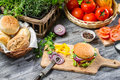 Homemade burger made ​​from vegetables and meat on old wooden table Royalty Free Stock Photos