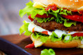 Homemade burger wooden background Royalty Free Stock Photos