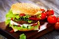 Homemade burger wooden background Stock Photo