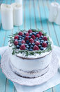 Homemade cake decorated berries on plate over wooden turquoise background Royalty Free Stock Photo