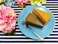 Homemade cake on dish with spring flower and space copy background Royalty Free Stock Photo