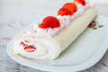 Homemade cake roll with strawberry cream Royalty Free Stock Photo