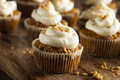 Homemade Carrot Cupcakes with Cream Cheese Frosting Royalty Free Stock Photo