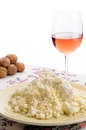 Homemade cheese walnuts and wine a tasty plate of fresh on the table a glass of rose some on the background Royalty Free Stock Image