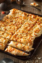 Homemade cheesy breadsticks with marinara sauce for dipping Royalty Free Stock Photo