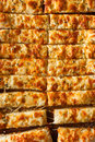 Homemade cheesy breadsticks with marinara sauce for dipping Royalty Free Stock Images