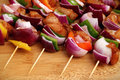 Homemade Chicken and Bacon Skewers Kebabs with Peppers Onions and Herb Marinate on wooden background Royalty Free Stock Photo