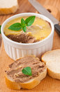 Homemade chicken liver pate basil and slices of white bread Royalty Free Stock Images