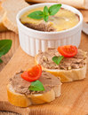 Homemade chicken liver pate basil tomatoes and slices of white bread Royalty Free Stock Photography