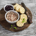 Homemade chicken liver pate, cranberry sauce and homemade cheese biscuits. Delicious snack or appetizer with wine. On light wooden Royalty Free Stock Photo