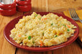 Homemade chicken rice casserole with vegetables on a rustic wooden table Stock Photos
