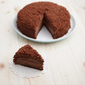 Homemade chocolate blackout cake filled chocolate pudding cut piece wooden table square recipe cooks illustrated Stock Image