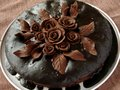 Homemade chocolate cake glazed decorated with roses and leaves Royalty Free Stock Images