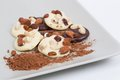 Homemade chocolate cookies with nuts and dried fruits in composition cocoa powder besides Stock Image