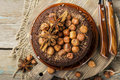 Homemade chocolate crazy cake with chocolate chips, nuts hazelnuts, cinnamon and spices for a cozy autumn tea party. Top Royalty Free Stock Photo