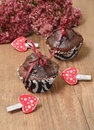 Homemade chocolate cupcakes for valentine s day with little hearts on the table Stock Images