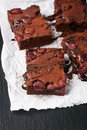 Homemade chocolate sweet brownies cakes with cherry and chocolate sauce or syrup on a dark background, horizontal
