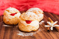 Homemade choux pastry with crimson curd cream and Royalty Free Stock Images