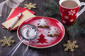 Homemade Christmas cookies in the shape of a Christmas tree, sprinkled with powdered sugar Royalty Free Stock Photo