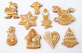 Homemade christmas ginger honey cookies white background star fir tree snowflake horse bell mushroom santa claus snowman rocking Royalty Free Stock Image