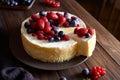 Homemade Christmas winter berry fruit cheesecake on wooden dark table. Creamy mascarpone dessert. Royalty Free Stock Photo