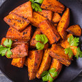 Homemade Cooked Sweet Potato with spices and herbs. Royalty Free Stock Photo