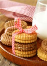 Homemade cookies sandwich with milk on a wooden table Stock Photography