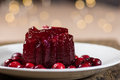 Homemade cranberry sauce on white plate with whole cranberries Stock Images