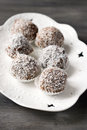 Homemade date candies covered chocolate shredded coconut Royalty Free Stock Images