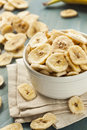 Homemade dehydrated banana chips in a bowl Stock Photography