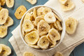 Homemade dehydrated banana chips in a bowl Stock Images
