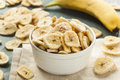 Homemade dehydrated banana chips in a bowl Royalty Free Stock Photography