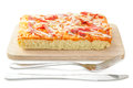 Homemade delicious fresh a slice of pizza on wooden plate. Royalty Free Stock Photo