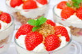 Homemade desert with cream chopped cookies and fresh strawberry Stock Photo