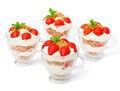 Homemade desert with cream chopped cookies and fresh strawberry on white Stock Photos
