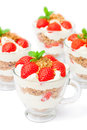 Homemade desert with cream chopped cookies and fresh strawberry on white Royalty Free Stock Photo