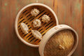 Homemade dim sum asian dumplings on a traditional bamboo steamer Stock Images