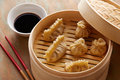 Homemade dim sum asian dumplings on a traditional bamboo steamer Stock Photos